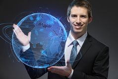 Business man pointing at blue sphere Royalty Free Stock Photography