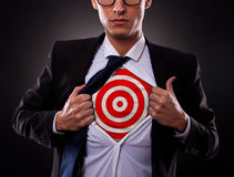 Business man showing a target under his shirt Royalty Free Stock Images