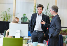 Business men in office talking Royalty Free Stock Image