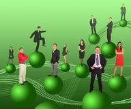 Business people on green balls Royalty Free Stock Images