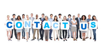 Business People Holding Placards Forming Contact Us Royalty Free Stock Images