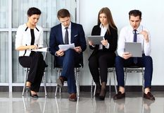 Business people waiting for job interview Royalty Free Stock Images