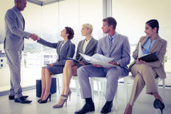 Business people waiting to be called into interview Stock Photography