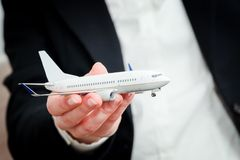 Business person holding airplane model. Transport, aircraft industry, airline Stock Photography