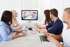 Business team attending video conference Royalty Free Stock Photography