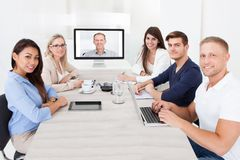 Business team attending video conference Stock Image