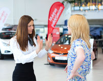 Business woman trying to calm down dissatisfied customer woman Stock Photo