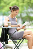 Business woman using tablet on break Royalty Free Stock Images