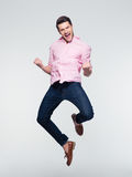 Businessman celebrating his success and jumping Stock Photos