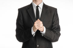 Businessman and gesture topic: a man in a black suit with a tie folded his hands in front of him and praying, meditating businessm Stock Photography