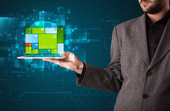 Businessman holding a tablet with modern software operational sy Royalty Free Stock Photography