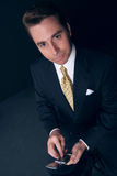 Businessman holds his cell phone Royalty Free Stock Photos