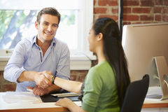 Businessman Interviewing Female Job Applicant In Office Stock Photo