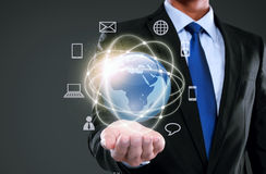 Businessman presenting global network media Stock Images