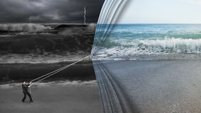 Businessman pulling open calm sea curtain covered dark stormy oc Stock Image