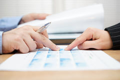 Businessman is reading report and discussing business data with Stock Photography