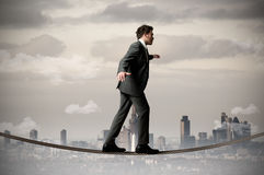Businessman on the rope Royalty Free Stock Photography