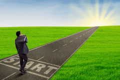 Businessman starting his journey to success Stock Images