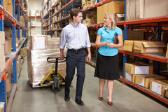 Businesswoman And Colleague In Distribution Warehouse Royalty Free Stock Photography