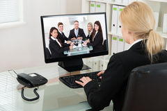 Businesswoman Video Conferencing With Colleagues On Computer Royalty Free Stock Photo