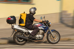 Busy messenger on motorcycle Royalty Free Stock Photos