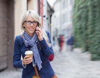 Busy woman rushing to work in the morning. Stock Photography