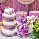 Cake and bottles of wine on a decorated wedding table Stock Images