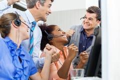 Call Center Employees Celebrating Success Stock Photo