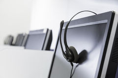 Call center headset isolated on screen Stock Images