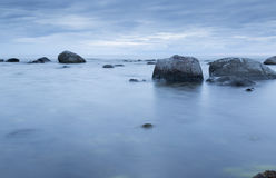 Calm Ocean with Rocks Stock Photography