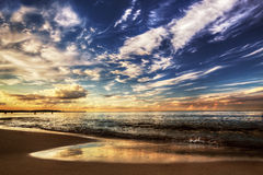 Calm ocean under dramatic sunset sky Royalty Free Stock Photo