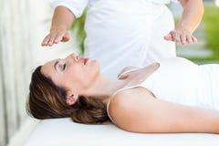 Calm woman receiving reiki treatment Stock Image