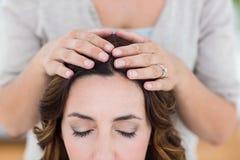 Calm woman receiving reiki treatment Stock Photos