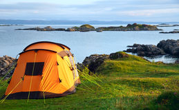 Camping tent on ocean shore Stock Photo