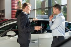 Car agent showing vehicle Stock Image