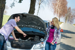 Car breakdown couple calling for road assistance Royalty Free Stock Image