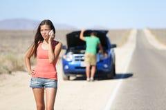 Car breakdown - woman calling auto service help Royalty Free Stock Photo