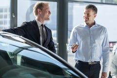 Car dealer showing vehicle Stock Image