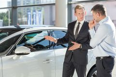 Car dealer showing vehicle Stock Photo
