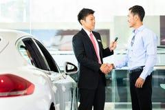Car Salesman selling auto to customer Stock Photos