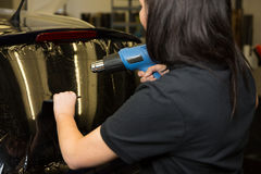 Car wrapper tinting vehicle window with foil Royalty Free Stock Photo
