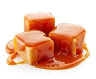 Caramel candies and caramel sauce Royalty Free Stock Photos