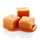 Caramel candies and caramel sauce Stock Image