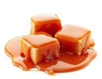 Caramel candies and caramel sauce Royalty Free Stock Photo