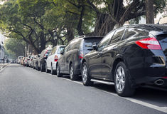 Cars parked row in city street, car park Stock Image