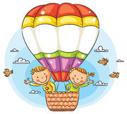 Cartoon kids travelling by air with copy space across the balloon Royalty Free Stock Image