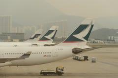 Cathay Pacific aircraft near boarding bridge Stock Photos