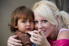 Caucasian lady telling her child to look at camera Royalty Free Stock Photos