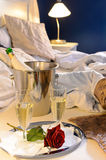 Champagne rose bed celebrate special occasion bedroom Royalty Free Stock Photos