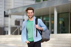 Cheerful college student standing outside with back Stock Photos